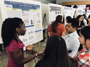 MARC student explaining research poster